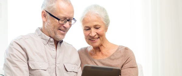 canadian senior couple with a tablet at home to know about reverse mortgage options and how it works