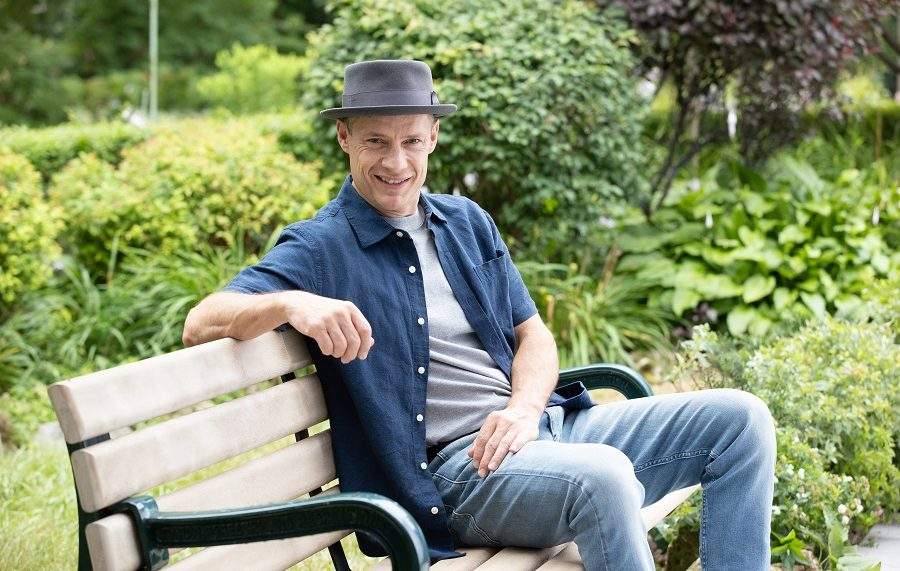 Kurt Browning sitting on a bench