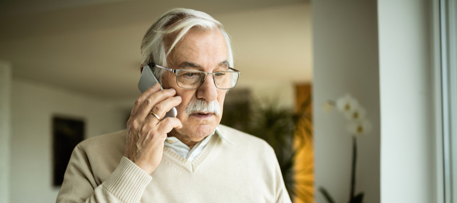 An older man talking on the his mobile phone