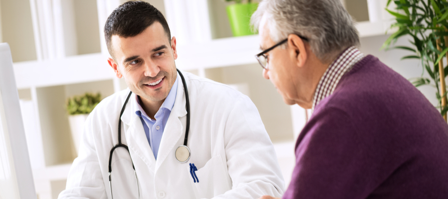 Doctor meeting with a male senior patient