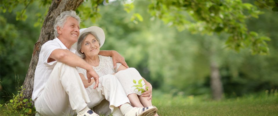 Senior couple relaxing outdoors and happy as they planned their life post retirement efficiently.