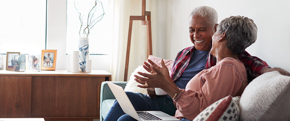 Senior couple enjoy their retirement years by consolidating their debt