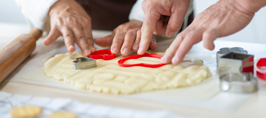 Senior couple hands making cookies