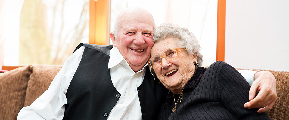 Smiling senior couple happy about knowing the hidden secrets of retirement planning.