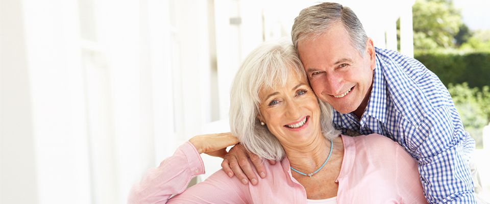 Senior Canadian retirees smiling and happy on securing a debt consolidation loan.