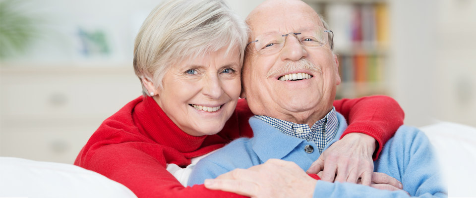 Senior Canadian couple happy with the home equity loan option they have chosen.