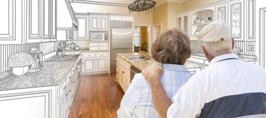 Senior couple looking over custom kitchen home renovations