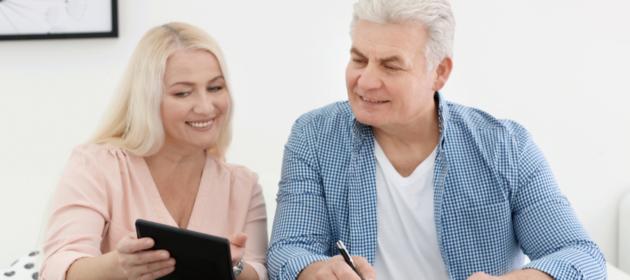 senior-couple-looking-over-pension-payment