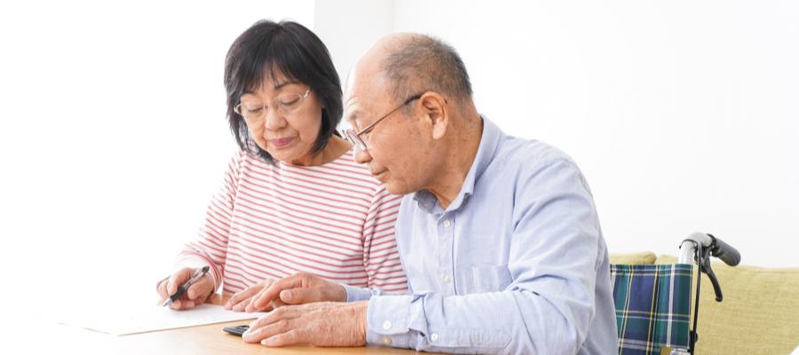 senior-couple-signing-line-of-credit-document