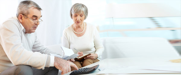 A Canadian senior couple using a reverse mortgage calculator to compute the loan amount due based on their home equity.