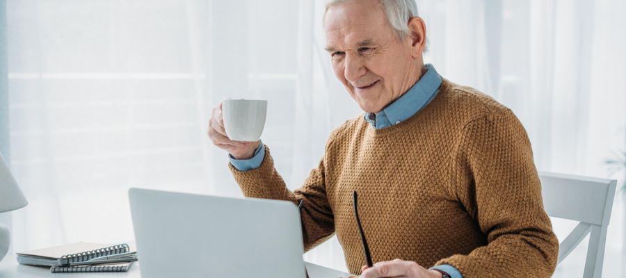 Senior man working on a laptop for RRIF withdrawal