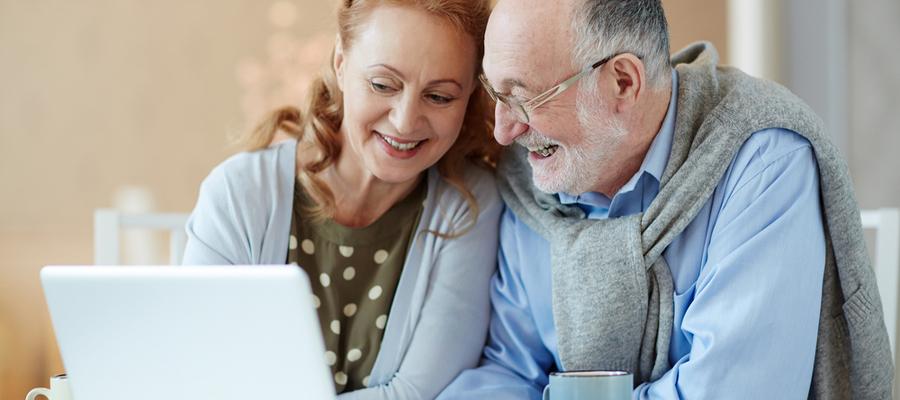 Senior smiling elderly couple video call