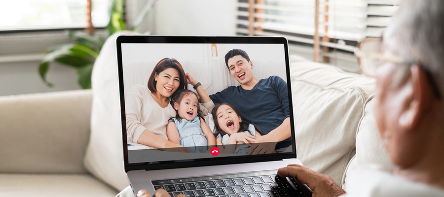 Older man talking to his family by video call